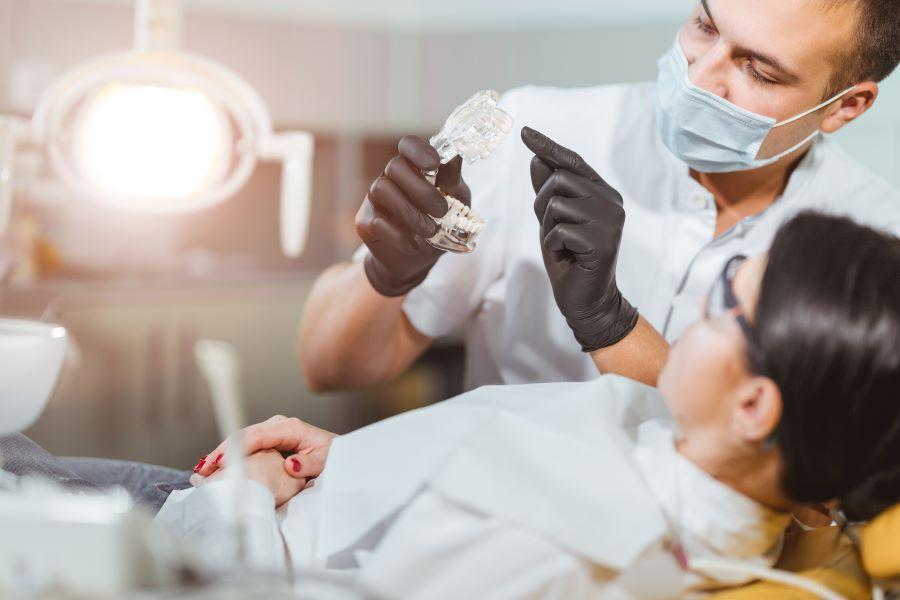 Dentist talking to patient - Children's Dental Center of Madison